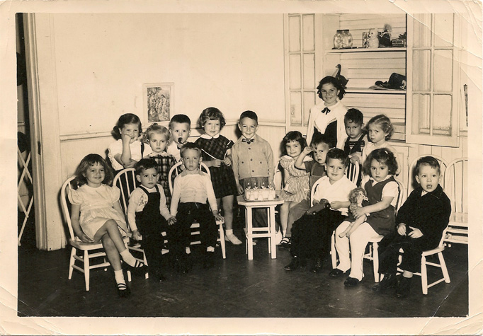 Preschool class photo, I'm seated far left.