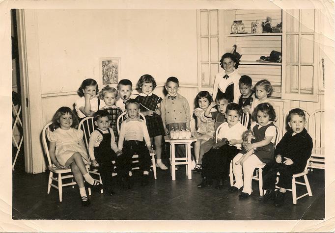 Preschool class photo, I'm seated far left.